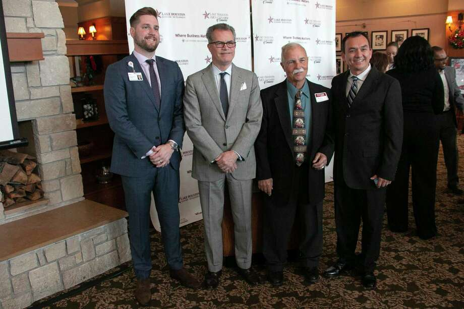 Lake Houston's Chamber of Commerce annual State of Healthcare luncheon on Nov. 19 at the Golf Club of Houston to understand healthcare at the federal, state and local levels. Left to right: John Corbeil, CEO at HCA Houston Healthcare Kingwood, Freddy Warner, Chief Government Relations Officer at Memorial Hermann Health System, Michael Carr with M.R. Carr Law Firm, and Sam Schrade, Lake Houston Chamber of Commerce board chairman and owner of DNA Studios. Photo: Savannah Mehrtens/Staff Photo / Savannah Mehrtens/Staff Photo