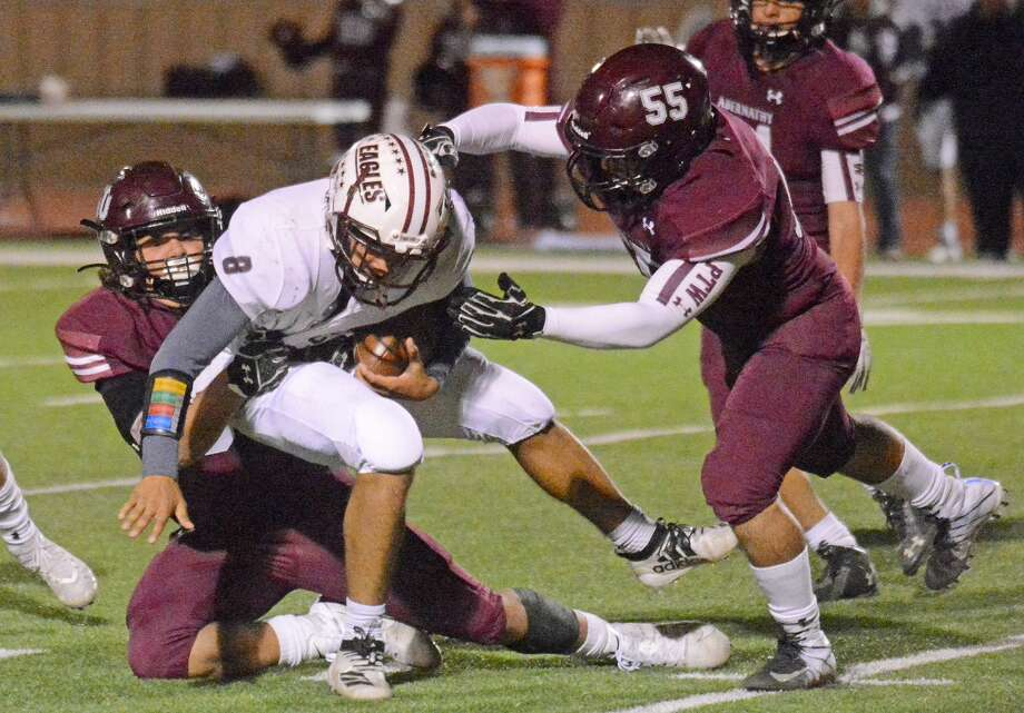 Abernathy defensive players Matthew DeAnda and Marcus Ybanez (55) team up to take down a Lubbock Roosevelt ball carrier during their District 2-3A Division II football game earlier this season in Antelope Stadium in Abernathy. Photo: Nathan Giese/Planview Herald
