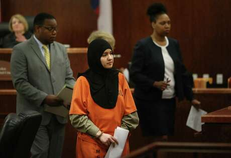 Nadia Irsan, who is accused of stalking her sister, her sister's husband, and her best friend, whom were gunned down in 2012, appears in the 184th State District Court at the Harris County Criminal Courthouse on Monday, May 5, 2015, in Houston. ( Mayra Beltran / Houston Chronicle )