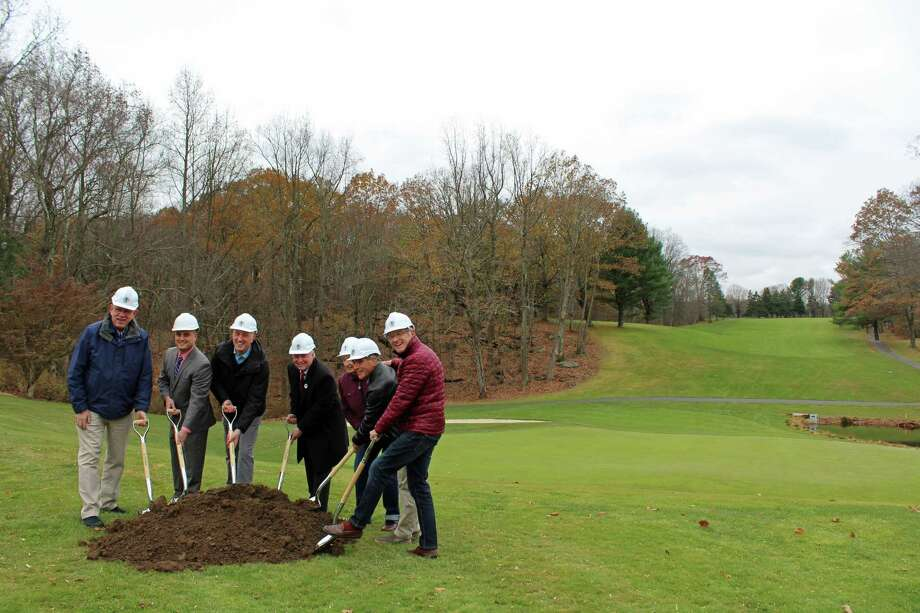 Town officials and building committee members broke ground at H. Smith Richardson golf course Wednesday. Photo: Rachel Scharf / Hearst Connecticut Media
