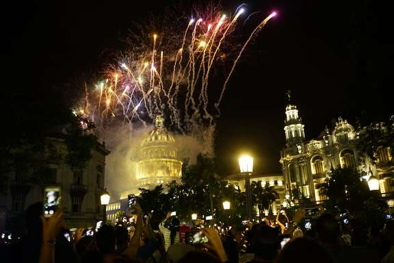 People take pictures of the fireworks at the Capitol during a gala as part of the celebration of the 500 years of the city in Havana, Cuba, Saturday, Nov. 16, 2019. Havana celebrates its 500th anniversary, a milestone event that has sparked reflection in the country, as it faces increasingly tense relations with the U.S. and serious economic challenges. (AP Photo/Ramon Espinosa)