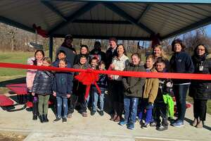 Students and faculty at Mohegan School gathered Friday for the grand opening of the school's outdoor classroom.