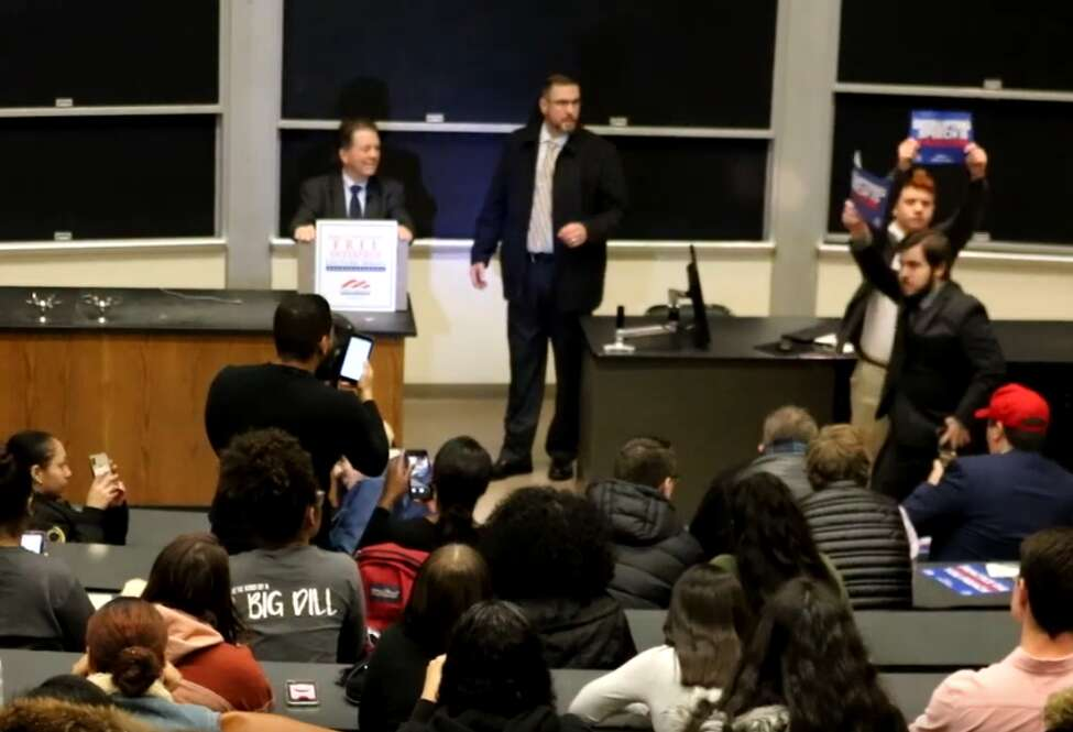 A speech by economist Arthur Laffer is interrupted by protesters in this screenshot of video captured by Binghamton Review, a student publication.