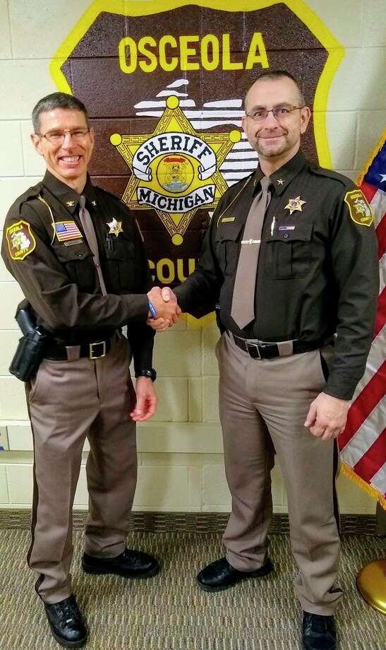Osceola County Sheriff Ed Williams (right) welcomed Mark Moore into his new position of undersheriff with the Osceola County Sheriff's Office on Monday. (Courtesy photo/Osceola County Sheriff's Office)