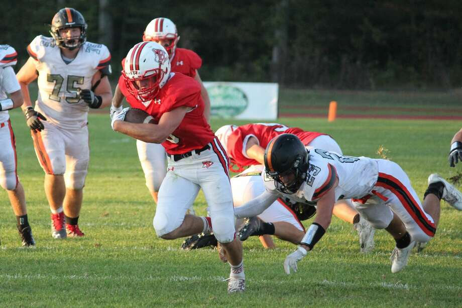 Spencer Steeves carries the ball during Benzie Central's home opener on Sept. 20. Photo: File Photo