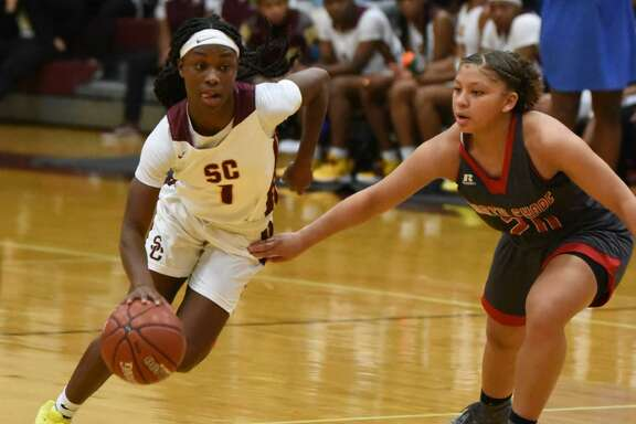 Summer Creek point guard Adaora Nwokeji drives to the basket against North Shore in a non-district game Tuesday night at the Bulldog gym.