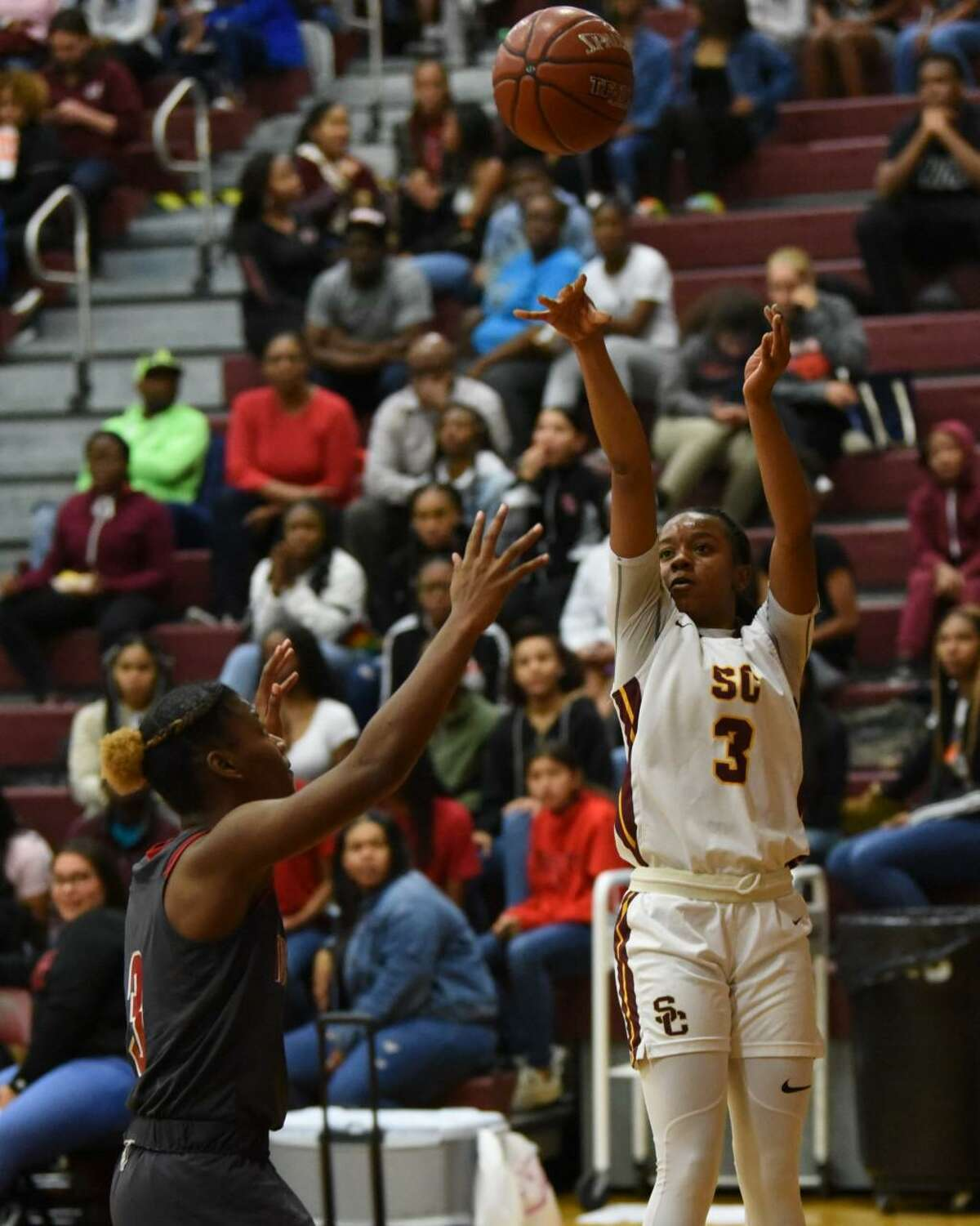 Summer Creek guard Mailyn Wilkerson shoots a 3-pointer from the corner in a non-district game Tuesday night at the Bulldog gym.