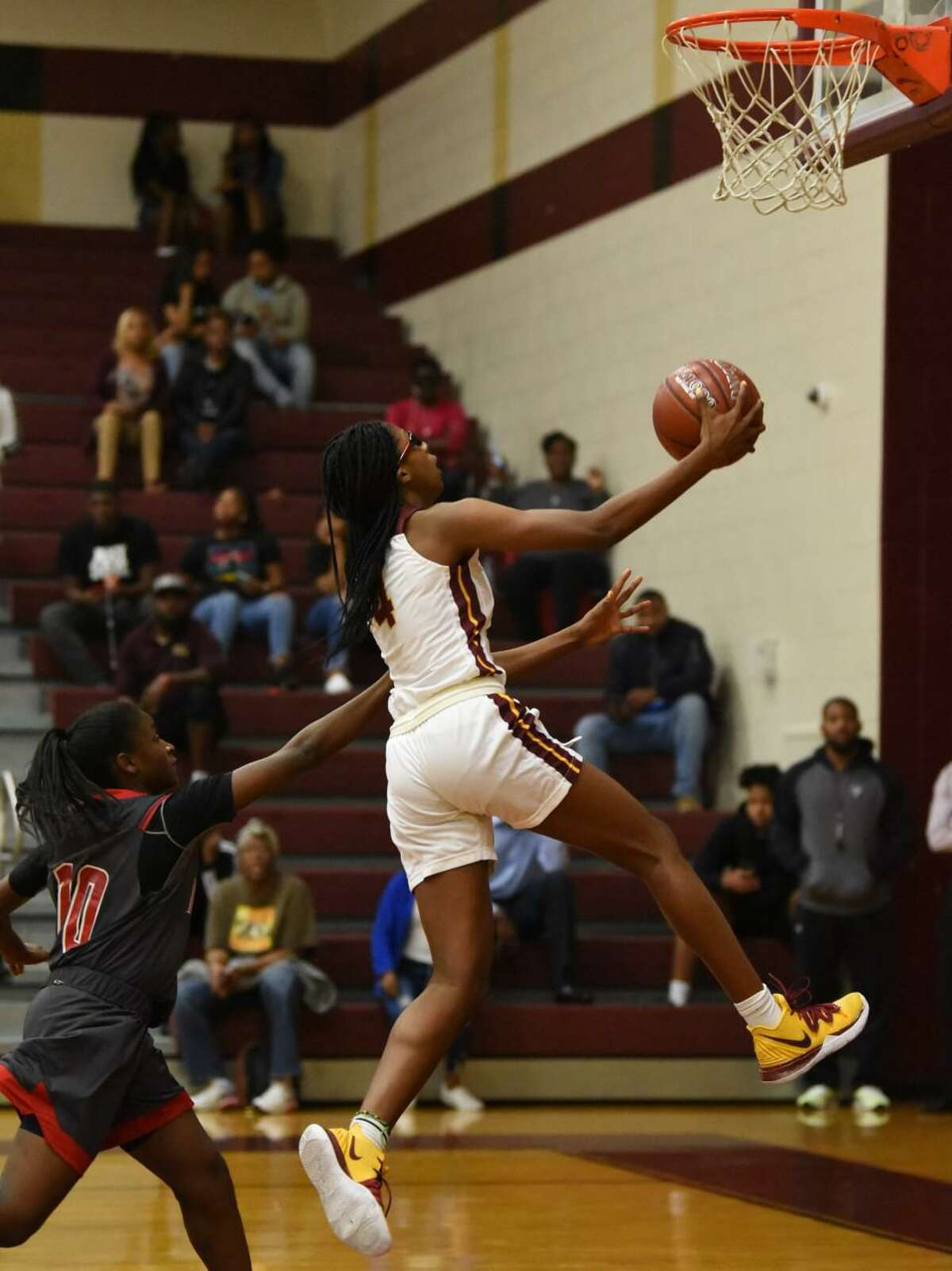 Summer Creek forward Kaitlyn Duhon goes for a layup in a non-district game Tuesday night against North Shore at the Bulldog gym.