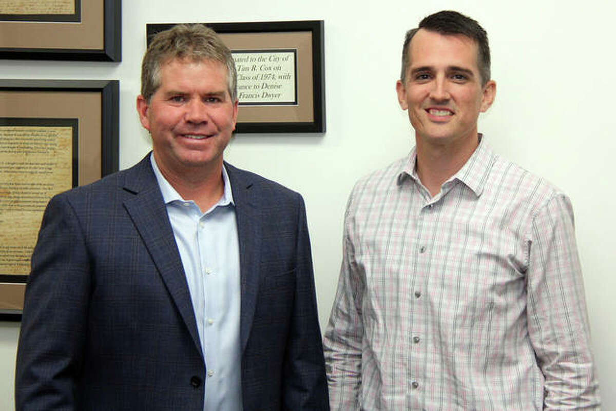 Nate Tingley, right, is the city's new parks director. With Tingley is Mayor Hal Patton, moments after Tingley was approved for the position. Tingley will replace Bob Pfeiffer, who will retire in early December after almost 45 years with the city.