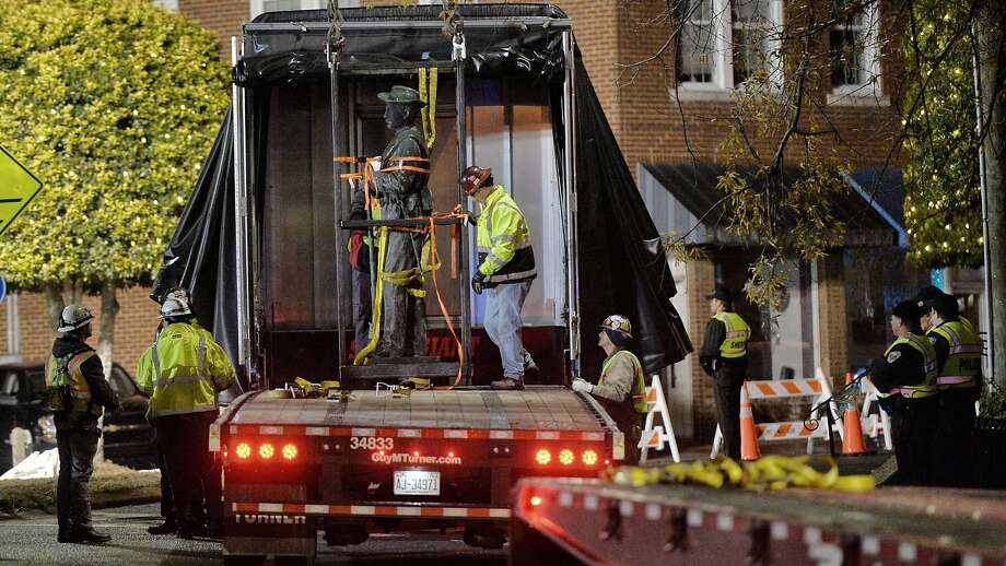 Workers secure the Confederate statue removed from the Chatham County Courthouse circle in downtown Pittsboro, N.C. shortly after removing it from its granite pedestal early Wednesday morning, Nov. 20, 2019. (Scott Sharpe/Raleigh News & Observer/TNS) Photo: Scott Sharpe / TNS