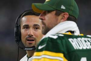 Head coach Matt LaFleur of the Green Bay Packers talks with quarterback Aaron Rodgers (12) on the sidelines against the Dallas Cowboys at AT&T Stadium on October 6, 2019, in Arlington, Texas. (Richard Rodriguez/Getty Images/TNS)
