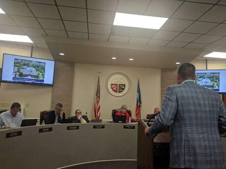 DHI Communities Managing Director Eric Overton talks to Tomball City Council members about the company's plan to build a new apartment complex on FM 2920.