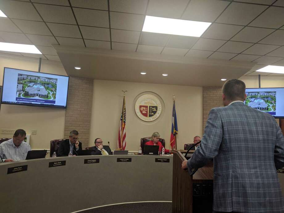 DHI Communities Managing Director Eric Overton talks to Tomball City Council members about the company's plan to build a new apartment complex on FM 2920. Photo: Paul Wedding