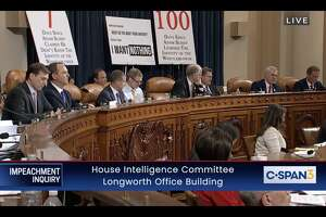 Signs erected by Republican House representatives are seen during the impeachment inquiry hearing with Ambassador Gordon Sondland on Nov. 20, 2019.