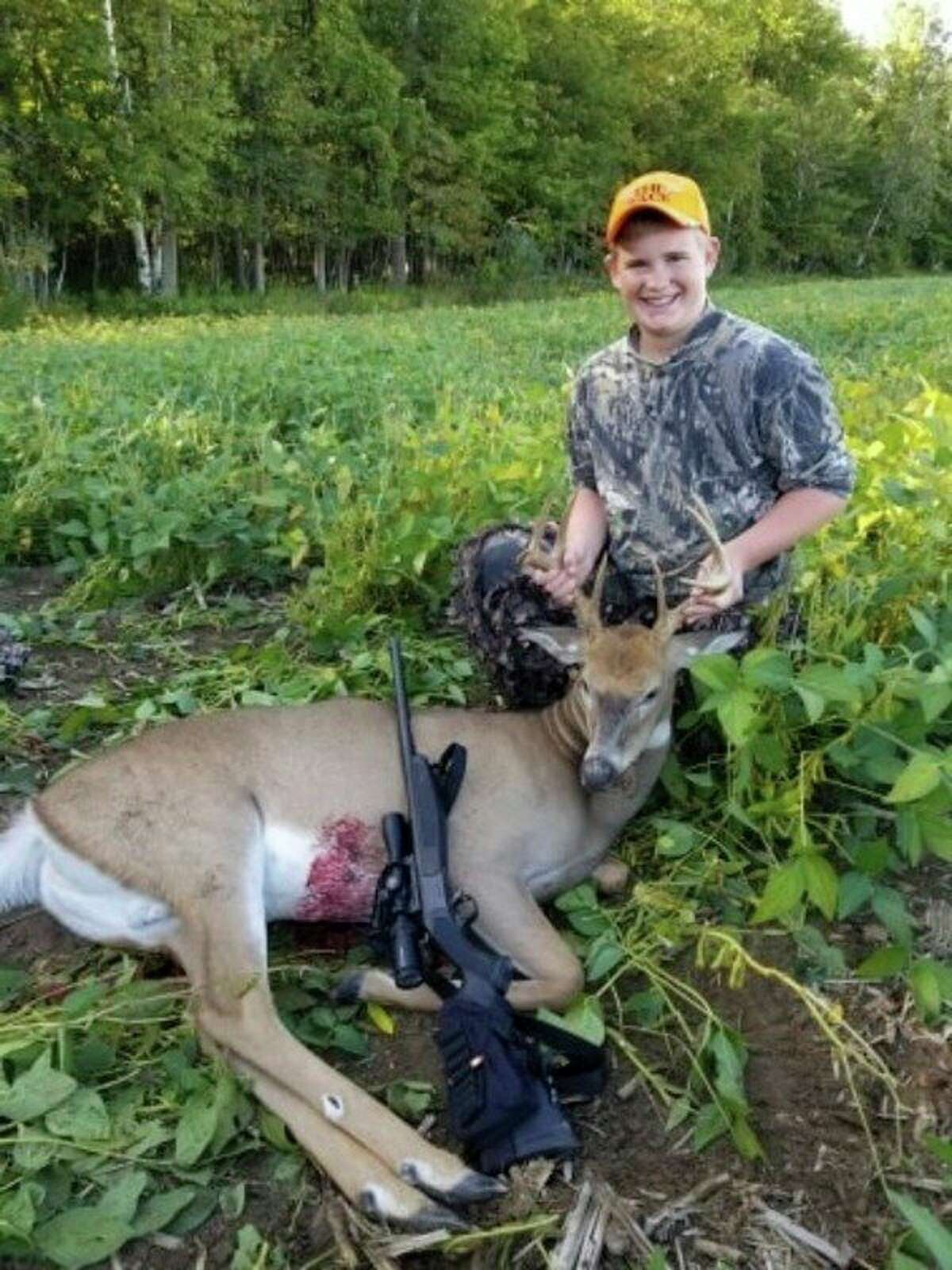 Noah Braun, 14, poses for a photo with a 9-point buck he recently shot. (Brian Braun/Courtesy Photo)