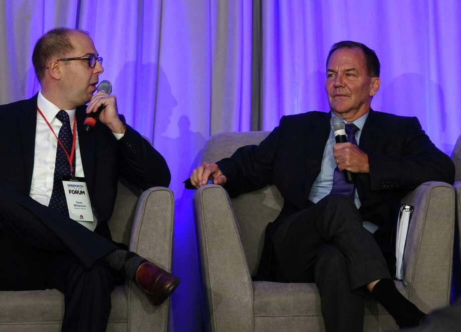 "Tudor Investment Corp. founder Paul Tudor Jones II, right, is interviewed by Albourne America Partner Travis Williamson during day one of the Greenwich Economic Forum at the Delamar Greenwich Harbor in Greenwich, Conn. Thursday, Nov. 15, 2018. The two day event ""brings together 300+ of the world's leading minds in finance and public policy to discuss and debate the global risk environment."" Greenwich billionaires Ray Dalio, of Bridgewater Associates, and Paul Tudor Jones, of Tudor Investment Corp., were featured speakers at the event. Photo: Contributed Photo / Contributed Photo / Greenwich Time Contributed Photo"
