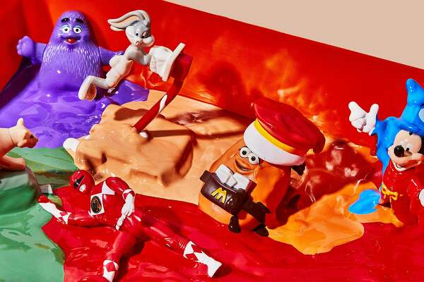 In a photo illustration, toys that come with children meals from fast-food restaurants like Burger King and McDonald's are melted, in New York, Nov. 11, 2019. Faced with growing public concern over single-use plastic, Burger King has vowed to stop giving away plastic toys with children's meals in Britain, and also plans to melt down old toys that customers return to stores and recycle them into playground equipment and reusable tray tables. (Chelsie Craig/The New York Times)