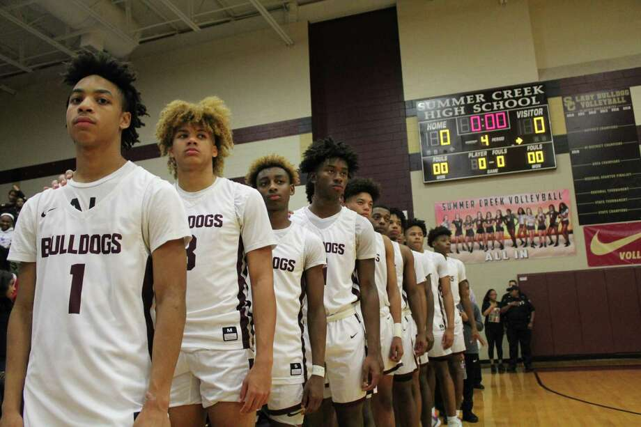 The Summer Creek basketball team standing during the national anthem. Photo: Marcus Gutierrez Staff Photo