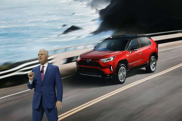 Toyota General Manager Jack Hollis talks about the 2021 Toyota RAV4 Prime at the AutoMobility LA auto show Wednesday, Nov. 20, 2019, in Los Angeles.