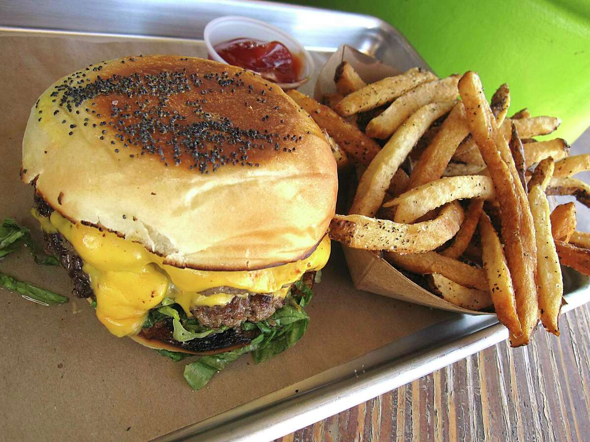 A house-baked bun completes a double cheeseburger at Mr. Juicy, a hamburger restaurant from chef Andrew Weissman. A second location has opened on San Pedro Avenue