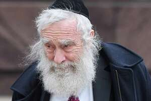 Rabbi Daniel Greer walks to  Superior Court in New Haven Nov. 20, 2019.