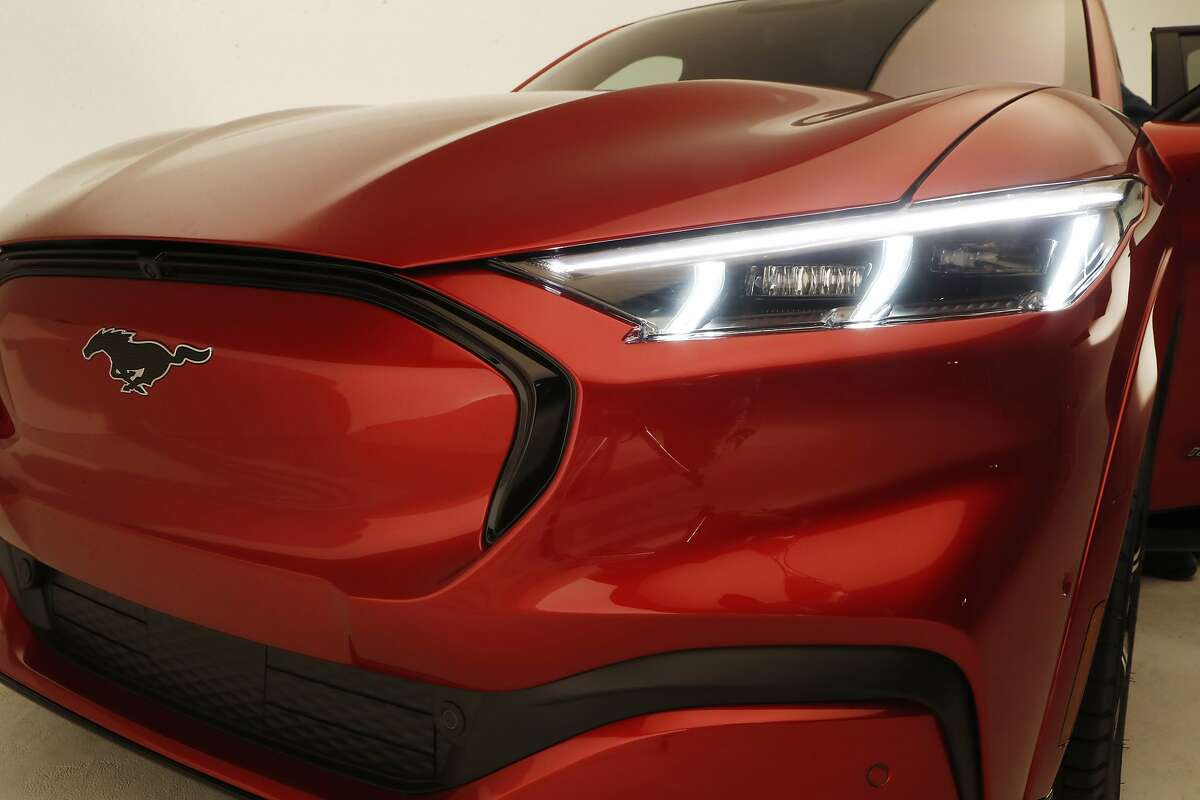 This Wednesday, Oct. 30, 2019 photo shows the front headlights of the new Ford Mustang Mach-E SUV in Warren, Mich. Ford is hoping to score big with the electric SUV for daily drivers that sort of looks like a Mustang performance car. The new SUV, to be unveiled just ahead of the Los Angeles Auto Show press days, should have range of up to 300 miles. It's one of dozens of electric vehicles coming globally by 2022. Automakers are eyeing what they think will be a growing market in the years to come.
