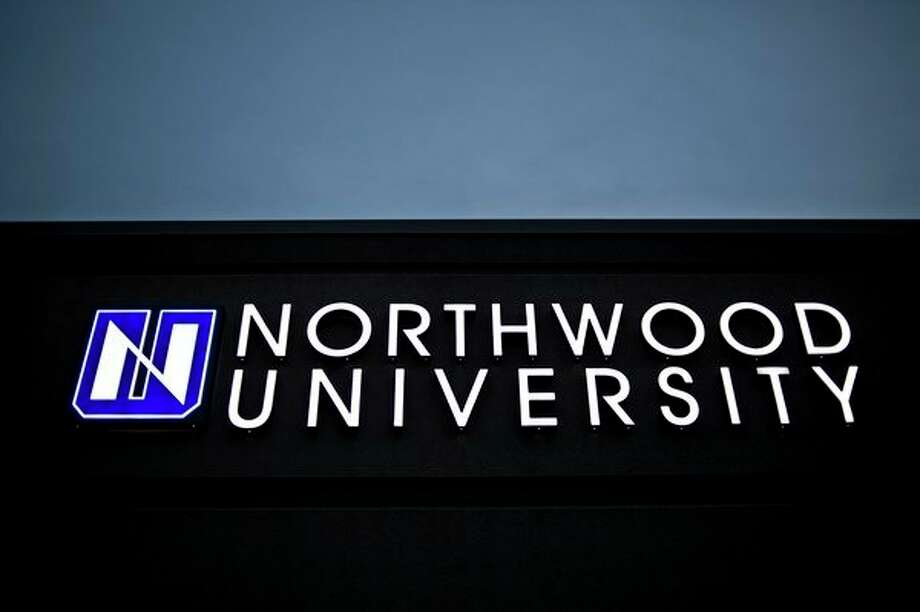The Northwood University sign is illuminated in 2015 at the Midland Historical Society, which doubles as the University's welcome center (Daily News file photo) / Midland Daily News