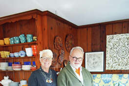 Cindy and Kirk Verseman spend a lot of time in their lower-level kitchen filled with vintage furniture and crockery.