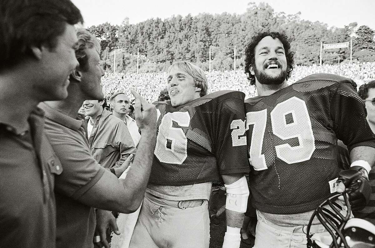 """Cal's Kevin Moen (26), and Ricardo Stelzmiller (79) are all smiles after Cal defeated Stanford, 25-20, on """"The Play"""" with Moen dodging Stanford band members to score the winning touchdown on Nov. 20, 1982."""