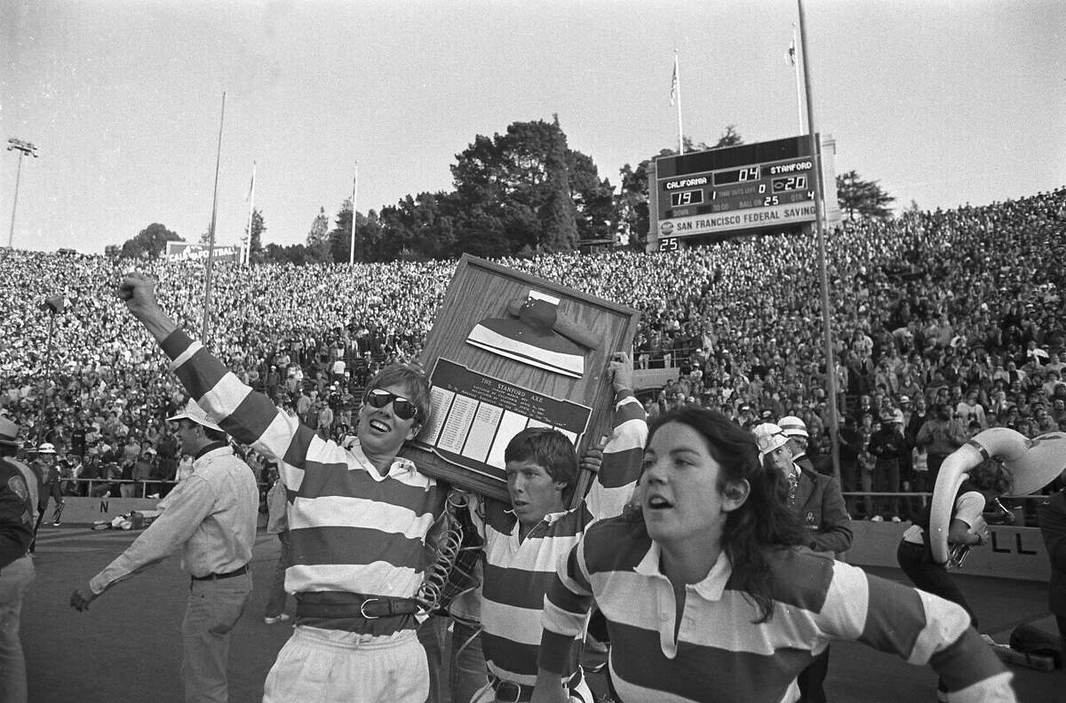 The Stanford band goes wild on the field at the end of the Cal-Stanford game in Berkeley, thinking they had won, as the scoreboard says, 20-19 with no time left, Nov. 20, 1982. Little did they know that Cal's Kevin Moen weaved his way through hundreds of people including the band to score a touchdown after time had run out, giving Cal a 25-20 win over Stanford. (AP Photo/Carl Viti)