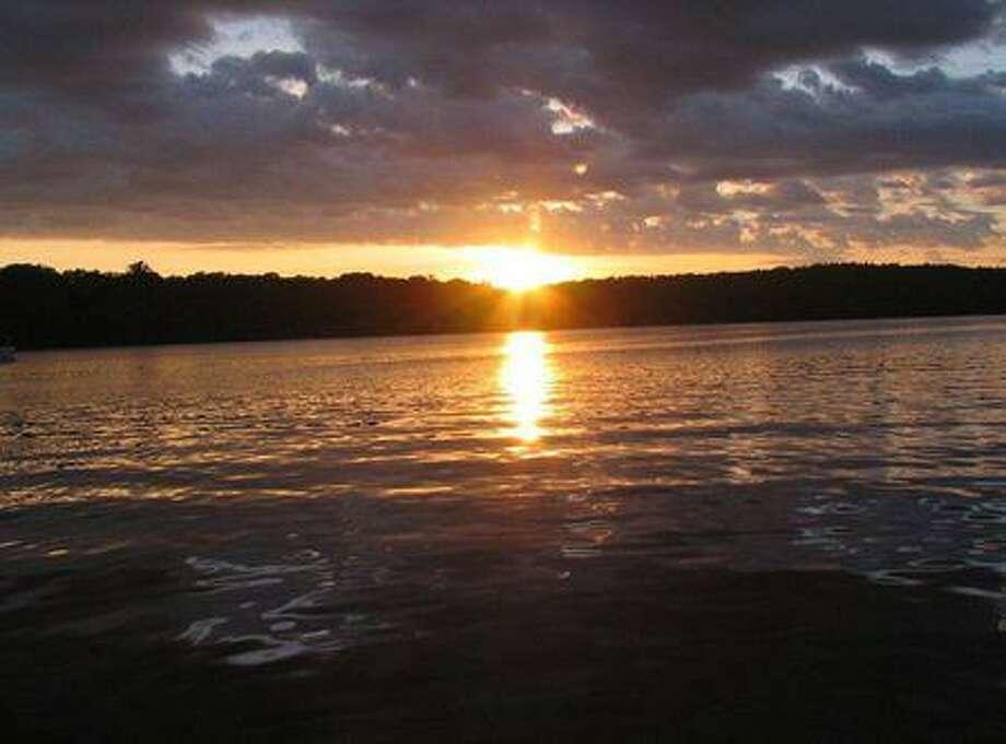 A sunset over the 380-acre Woodridge Lake in Goshen Photo: Contributed / Woodridge Lake Association