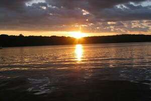 A sunset over the 380-acre Woodridge Lake in Goshen
