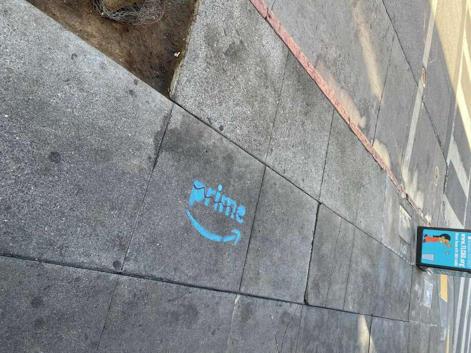 "A series of controversial Amazon Prime ads were spray-painted in numerous spots on Larkin Street. The company told SFGATE they are not responsible, but such ""corporate graffiti"" has been a persistent issue in the city. Photo: Tenderloin Community Benefit District, TLCBD.org"