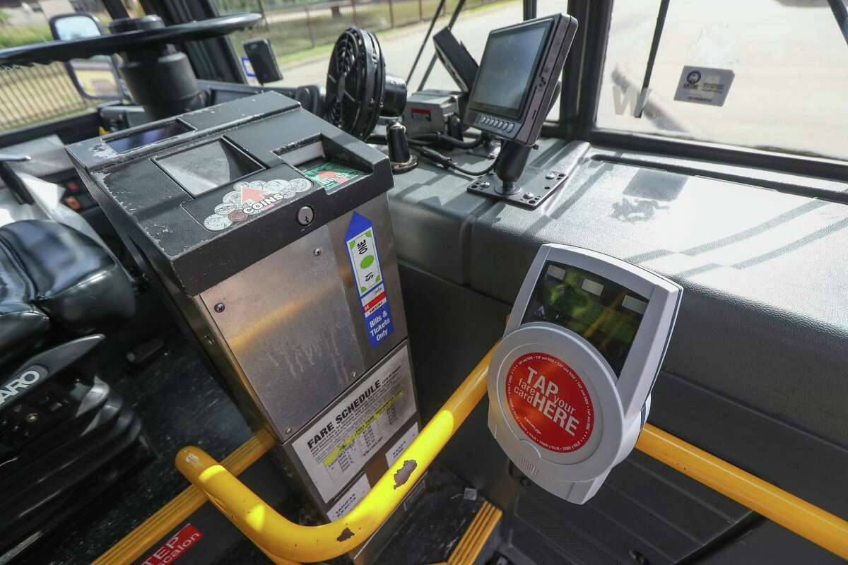 Metropolitan Transit Authority bus riders use Q cards, smartphone apps or cash to hop aboard a bus Nov. 20, 2019, in Houston. Metro is in the early steps of revamping its fare system, which will eventually allow for payments using Apple Pay and other options.