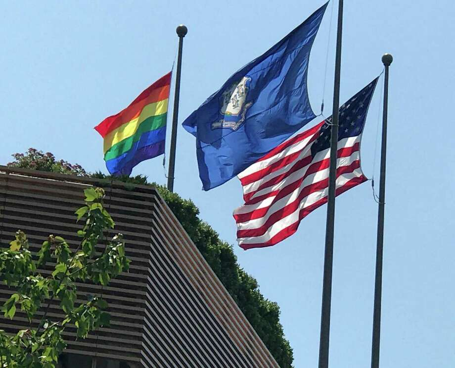 A gay pride flag along with the state and U.S. flag in Stamford. Photo: File Photo / Connecticut Post