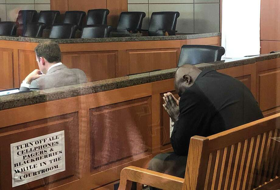 Former HPD officer Gerald Goines prays in court before turning himself in. He was the lead officer on the deadly drug raid on Harding Street. Photo: Karen Warren,  Staff Photographer / Houston Chronicle