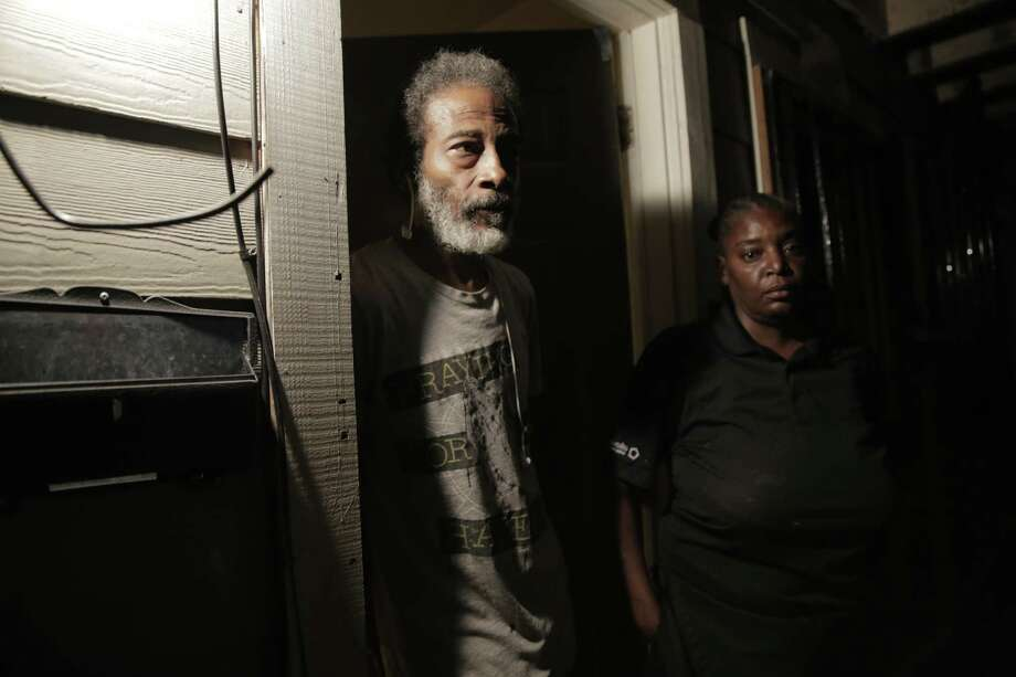 Sherman and Michelle Brooks outside their apartment in Houston. Members of the Houston Police Department's narcotics division busted down the door of their home, apartment No. 1, looking for a drug suspect. But the suspect, who was arrested six months later, actually lived nextdoor in apartment No. 2. Photo: Elizabeth Conley,  Staff Photographer / © 2018 Houston Chronicle