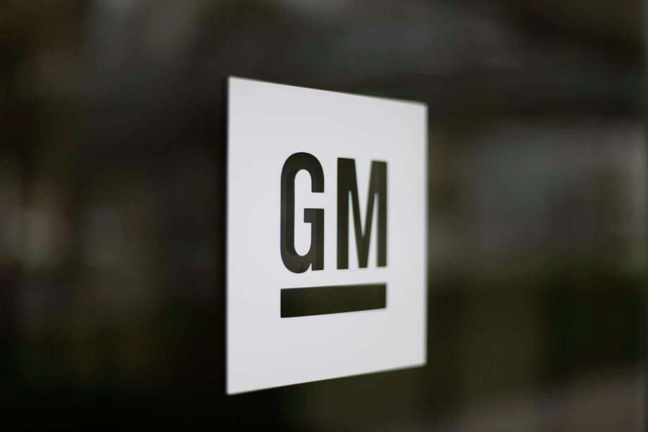 FILE - This May 16, 2014, file photo, shows the General Motors logo at the company's world headquarters in Detroit. General Motors is suing Fiat Chrysler, alleging that its crosstown rival got an unfair business advantage by bribing officials of the United Auto Workers union. The lawsuit, filed Wednesday, Nov. 20, 2019,  in U.S. District Court in Detroit, alleges that FCA was involved in racketeering by paying millions in bribes to get concessions and gain advantages in three labor agreements with the union. (AP Photo/Paul Sancya, File) Photo: Paul Sancya / Copyright 2016 The Associated Press. All rights reserved. This m