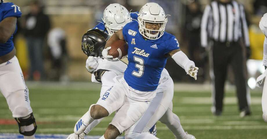 Tulsa running back Shamari Brooks runs the ball against Central Florida during an NCAA college football game Friday, Nov. 8, 2019, in Tulsa, Okla. (Brett Rojo/Tulsa World via AP) Photo: Brett Rojo/Associated Press