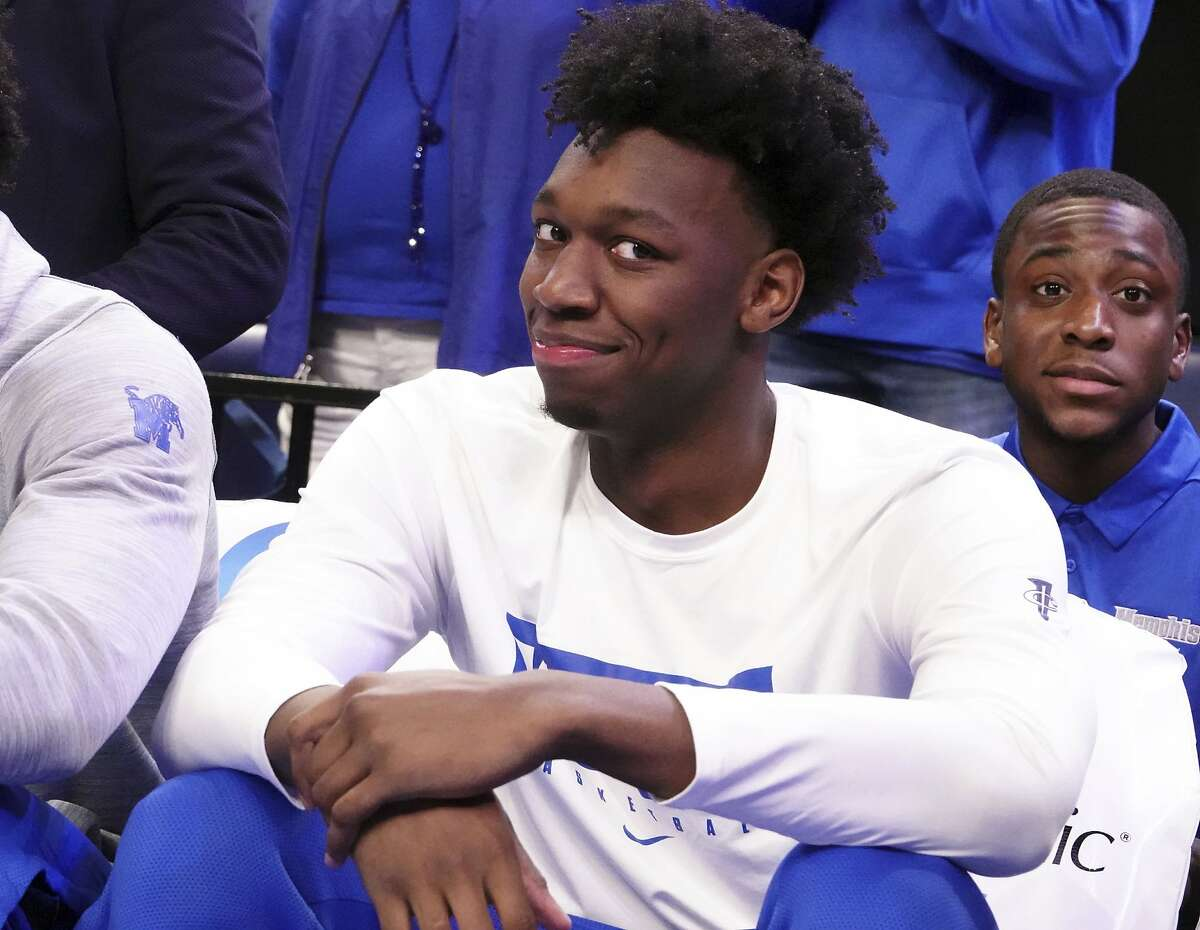 Memphis' James Wiseman smiles from his spot on the bench as he sat out of an NCAA college basketball game against Alcorn State Saturday, Nov. 16, 2019, in Memphis, Tenn. (AP Photo/Karen Pulfer Focht)