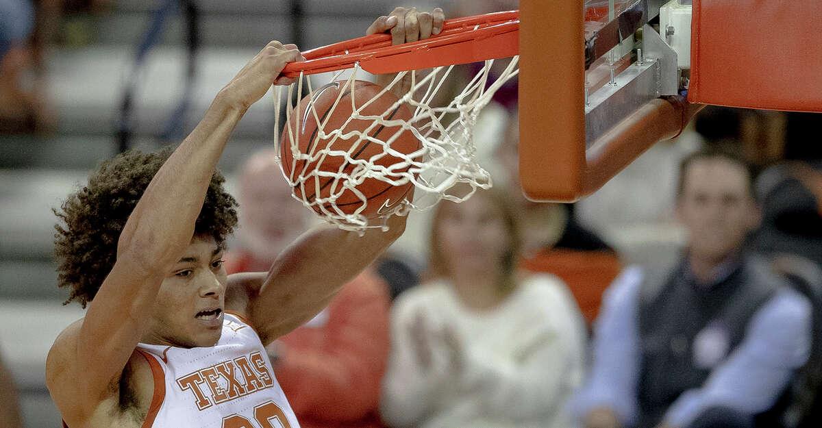 Texas forward Jericho Sims (20) dunks against California Baptistduring an NCAA college basketball game Tuesday, Nov. 12, 2019, in Austin, Texas. (Nick Wagner/Austin American-Statesman via AP)