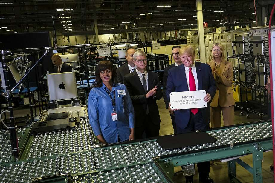 President Donald Trump tours Flextronics International, LTD in Austin, Texas, with Apple CEO Tim Cook, left, on Wednesday, Nov. 20, 2019. Flextronics International is one of the manufacturers of Apple's iMac computers. (Pete Marovich/The New York Times) Photo: Pete Marovich, NYT