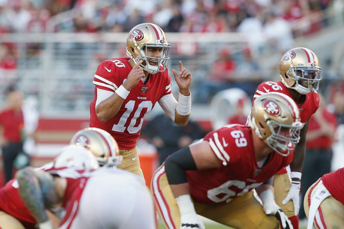 Quarterback Jimmy Garoppolo #10 of the San Francisco 49ers talks to teammates at the line of scrimmage in the fourth quarter against the Arizona Cardinals at Levi's Stadium on November 17, 2019 in Santa Clara, California. (Photo by Lachlan Cunningham/Getty Images)