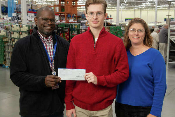 SIUE's WSIE recently received a $1,000 donation from the Walmart Foundation. Pictured from left are Michael Robinson, general manager of the Glen Carbon Sam's Club; Jonathan Koons, WSIE intern; and Stephanie Lewis, WSIE account executive.