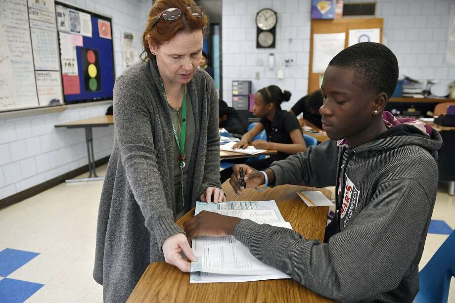 Crosby High School algebra teacher Jennifer Desiderio works with Lyndon Frederic in her class in Waterbury, Conn., on Nov. 7. Photo: Jessica Hill / Associated Press