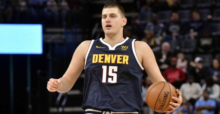 Denver Nuggets center Nikola Jokic (15) plays in the first half of an NBA basketball game Sunday, Nov. 17, 2019, in Memphis, Tenn. (AP Photo/Brandon Dill)