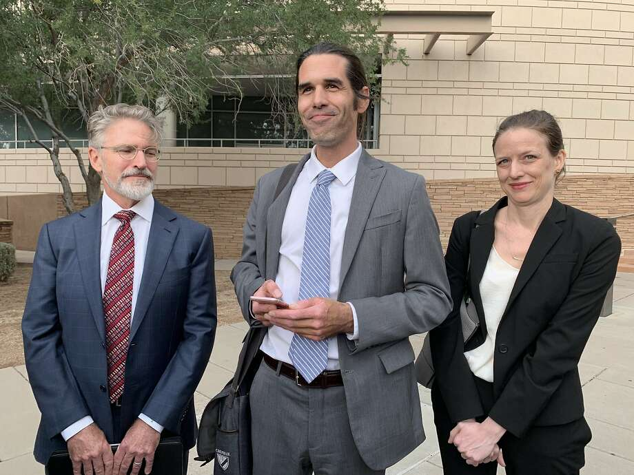Scott Warren, center, of Ajo, Ariz. celebrates with his attorneys Amy Knight, right, and Greg Kuykendall outside court in Tucson, Ariz. on Wednesday, Nov. 20, 2019, after being acquitted of two counts of harboring in a case that garnered international attention. Prosecutors said Warren illegally helped two migrants avoid authorities. He said he was fulfilling his humanitarian duties by helping two injured men. (AP Photo/Astrid Galvan) Photo: Astrid Galvan, Associated Press