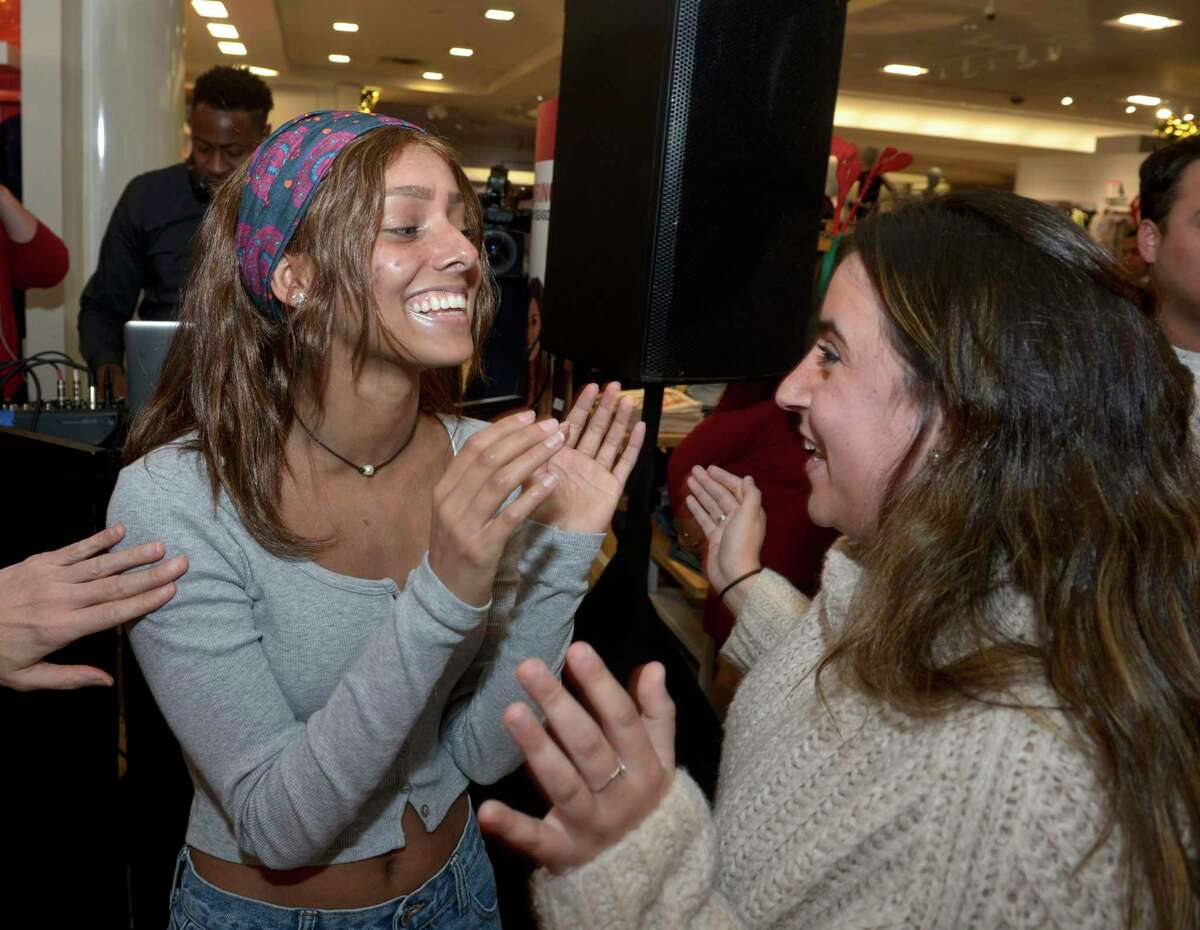 Alexandra Chakar, left, of Danbury, greets Missy Cohen, her nurse from Connecticut Children's Hospital in Hartford, as she had her wish to go to Australia granted by Macy's and Make-A-Wish Connecticut at a celebration at the store on Wednesday afternoon. Chakar, who is battling leukemia, will travel to Australia in the spring. November 20, 2019, in Danbury, Conn.
