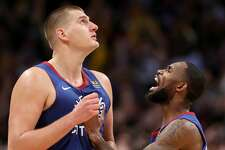 DENVER, COLORADO - NOVEMBER 08: Nikola Jokic #15 of the Denver Nuggets celebrates with Will Barton III #5 after making the game winning basket in the final seconds against the Philadelphia 76ers in the fourth quarter at the Pepsi Center on November 08, 2019 in Denver, Colorado. NOTE TO USER: User expressly acknowledges and agrees that, by downloading and or using this photograph, User is consenting to the terms and conditions of the Getty Images License Agreement. (Photo by Matthew Stockman/Getty Images)