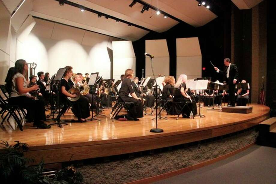 Howard Wilson conducts Manistee and Benzie County Honors Band. (Photo/Robert Myers)